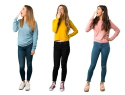 A full-length shot of a group of people with colorful clothes yawning and covering wide open mouth with hand on isolated white background on isolated white background