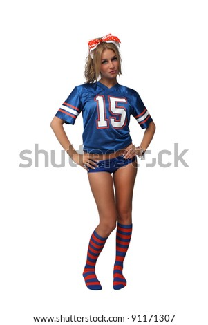 A full-length shot of a sexy young blonde wearing booty shorts and a football jersey with matching socks.  Isolated on a white background with generous copyspace.