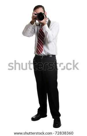 A full length view of a photographer using a DSLR, isolated against a white background.