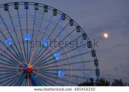 a full moon rises behind the...