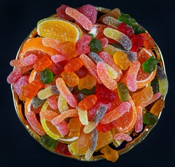 A full plate of colorful marmalade candy. a top view. Marmalade background.