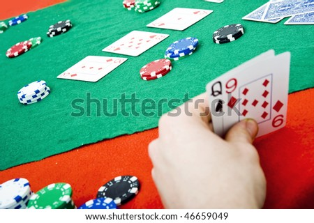 A full poker table after the flop with various cards and stacks of chips