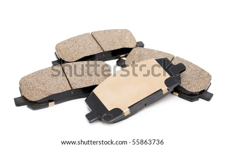 a full set of brake pads over white background