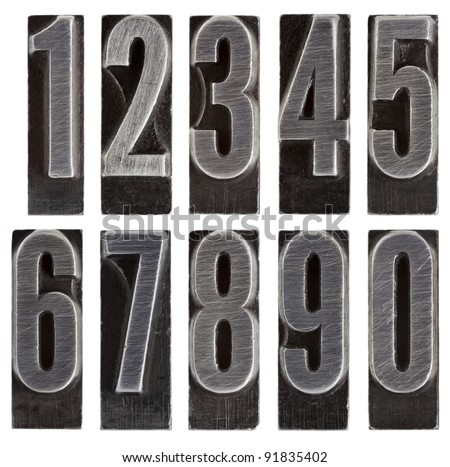 a full set of ten arabic numerals 0 to 9 in old grunge metal letterpress printing blocks isolated on white