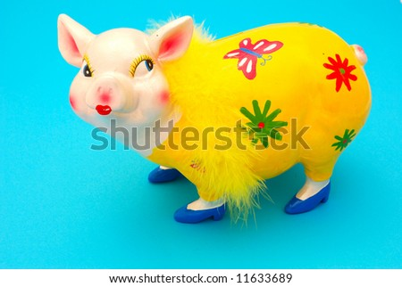 A funny colorful piggy bank for kids on blue background