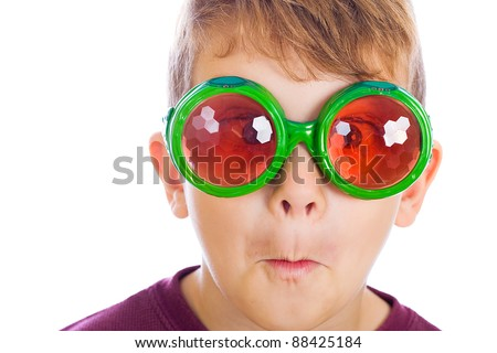 A funny kid wearing bug eyed glasses.