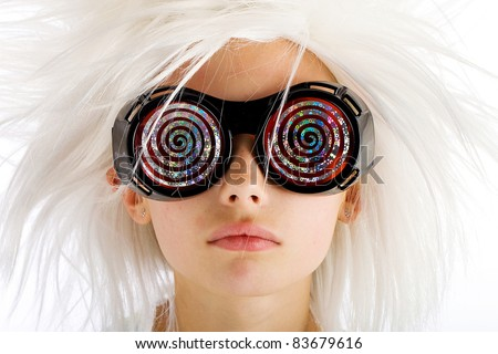A funny looking kid with crazy white hair and wild hypnotic glasses.