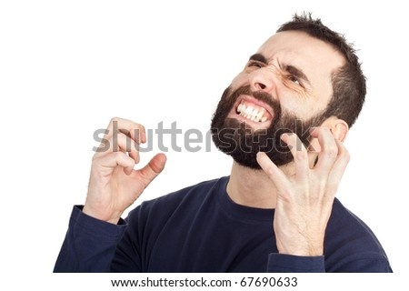 A furious bearded man rising his hands in anger and showing his teeth in the process. Isolated against a white background.