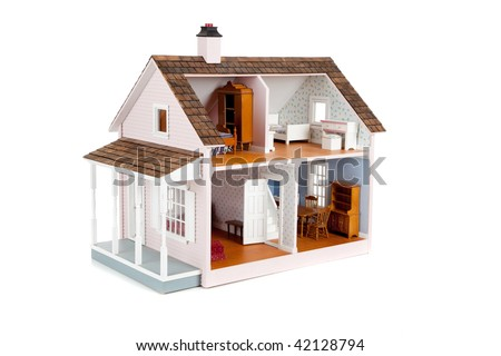 a furnished pink doll house on a white background