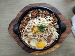 a fusion food consist noodle pork and egg colaboration