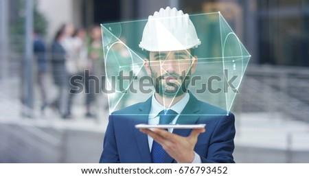 A futuristic architect, engineer, builder, in a suit, in a white helmet, holds a tablet with a holographic hologram geometric project of triangles. Concept: future, construction, technology, business.