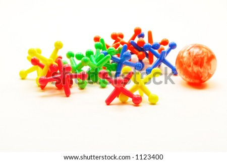 A game of Jacks in bright colours. - stock photo