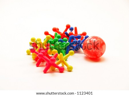 A game of Jacks in bright colours (focus on ball).