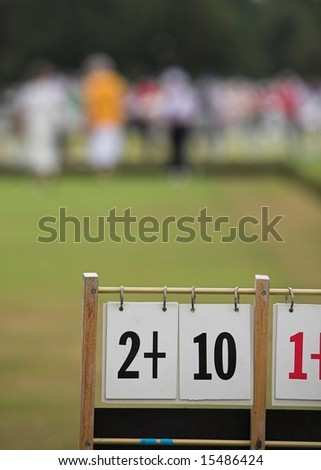 A game of lawn bowls with focus on the scoreboard.
