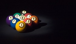 A game of nine ball, cued up and ready to go.
