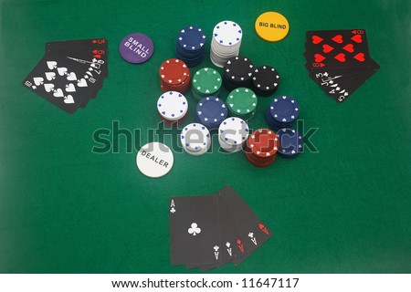 A game of poker on the basic green cloth.