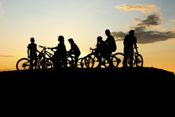 A Gang doing Bike with a yellow sunset
