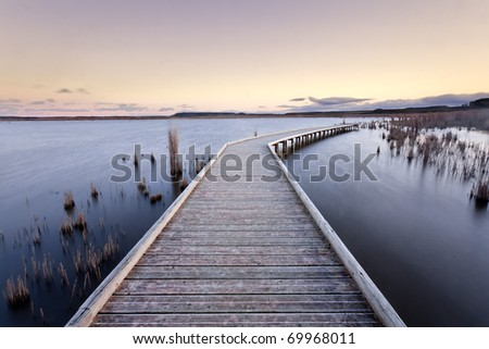 A gangway over a lake during the sunset. Lake of Pitillas, Navarra (Spain)