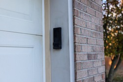 A garage door opener keypad on a residential home
