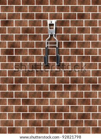 A garage storage hook on a  red brick wall