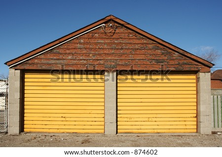 A garage with yellow doors.
