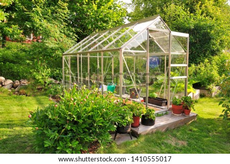 A garden center greenhouse with a colorful display of potted plants and flowers  Stock photo ©