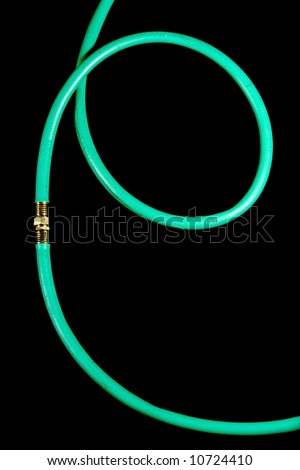 A garden hose coiled with a sprayer
