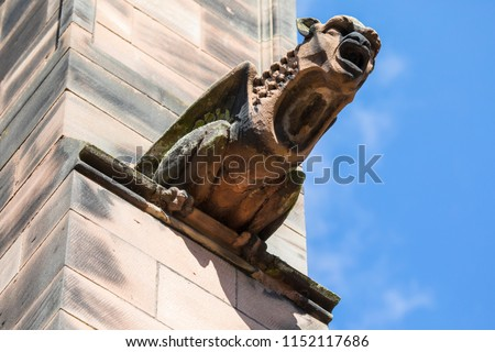 A gargoyle on the exterior of Chester Cathedral, in the historic city of Chester in Cheshire, UK.