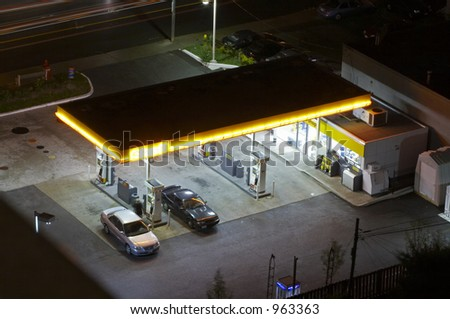 A gas station at night. Shell