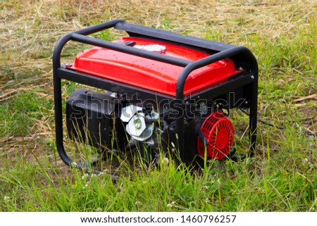 A gasoline generator is used in the forest to generate electricity. #1460796257
