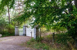A gate in the woods. Photo taken in Ljunghusen, Sweden. This place became popular as a summer resort at the beginning of the 1900:th century. Today it is mostly a residential area.