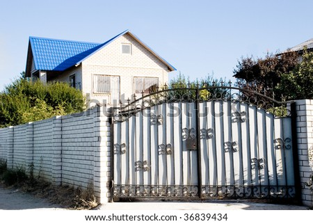 A gate of a modern village courtyard. Real estate related.