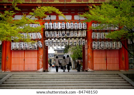 a gate of a temple with lanterns hanging up