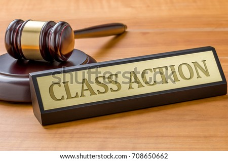A gavel and a name plate with the engraving Class action #708650662