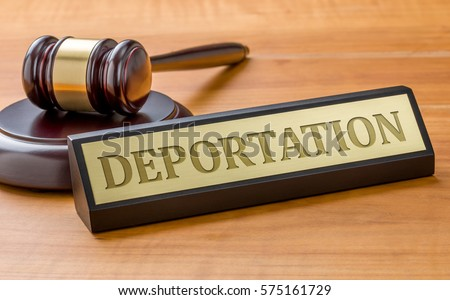 Shutterstock A gavel and a name plate with the engraving Deportation