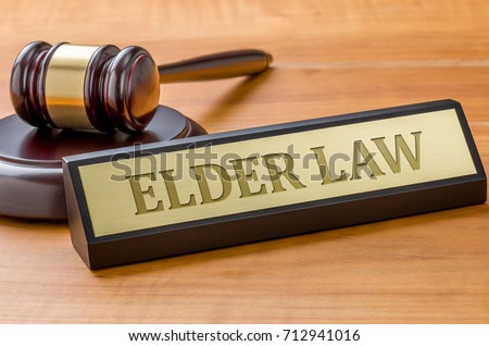 A gavel and a name plate with the engraving Elder law