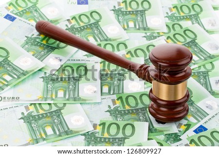 a gavel and euro banknotes. legal costs and budget