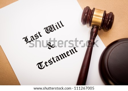 """A gavel and soundboard on top of a """"Last Will and Testament"""" contract, with a antique-like background."""