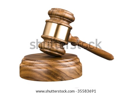 A gavel and wooden block isolated on white for use with any legal or auctioneer inferences.