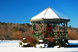 A gazebo is decorated for Christmas in a park