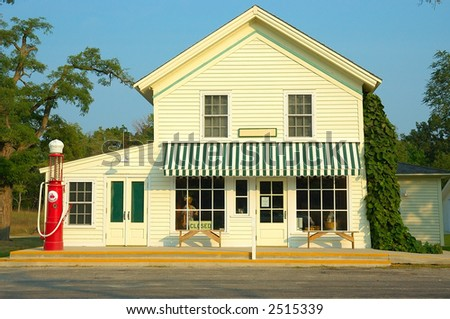 A general store and gas station with an antique gas pump outside that is now simply decorative, no longer in use.