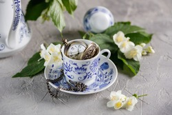 A gentle still-life with a tea set and jasmine flowers.