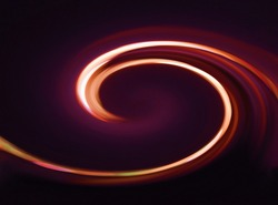 A gentle swirl of glowing light in the night with hues of orange and purple radiating out. The dark background and curved lights resembling the motion of cars on an exit ramp from a highway.