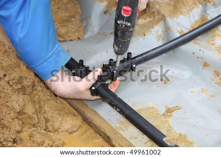 A geothermal heating system is built. The heating pipes are laid into the ground.