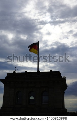 A German flag on the Reichstag #1400913998