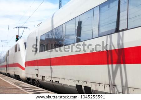 a german train passes a train station