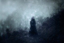 A ghostly blurred woman in a dress standing floating on a country path. With a grunge, vintage textured edit.