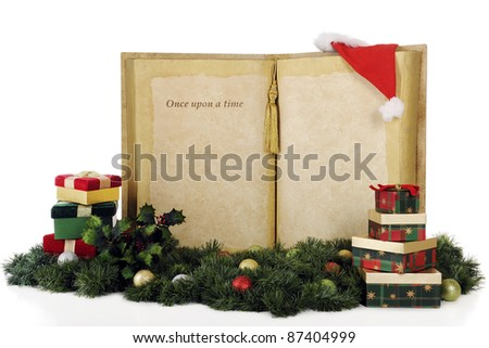"A giant book with the words, ""Once upon a time..."" with plenty of space for your copy.  The books is surrounded by Christmas gifts, decor and Santa's hat.  On a white background."