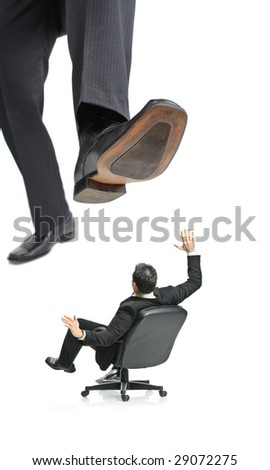 A giant foot about to squish a businessman in a chair isolated on a white background