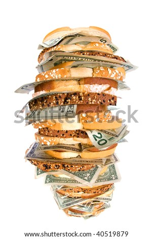 A giant, fresh money sandwich with multiple types of bread and cash denominations for use on many financial, food and economic inferences.